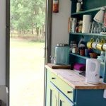 Kitchen in glamping caravan at Little Oak Camping, Nottinghamshire